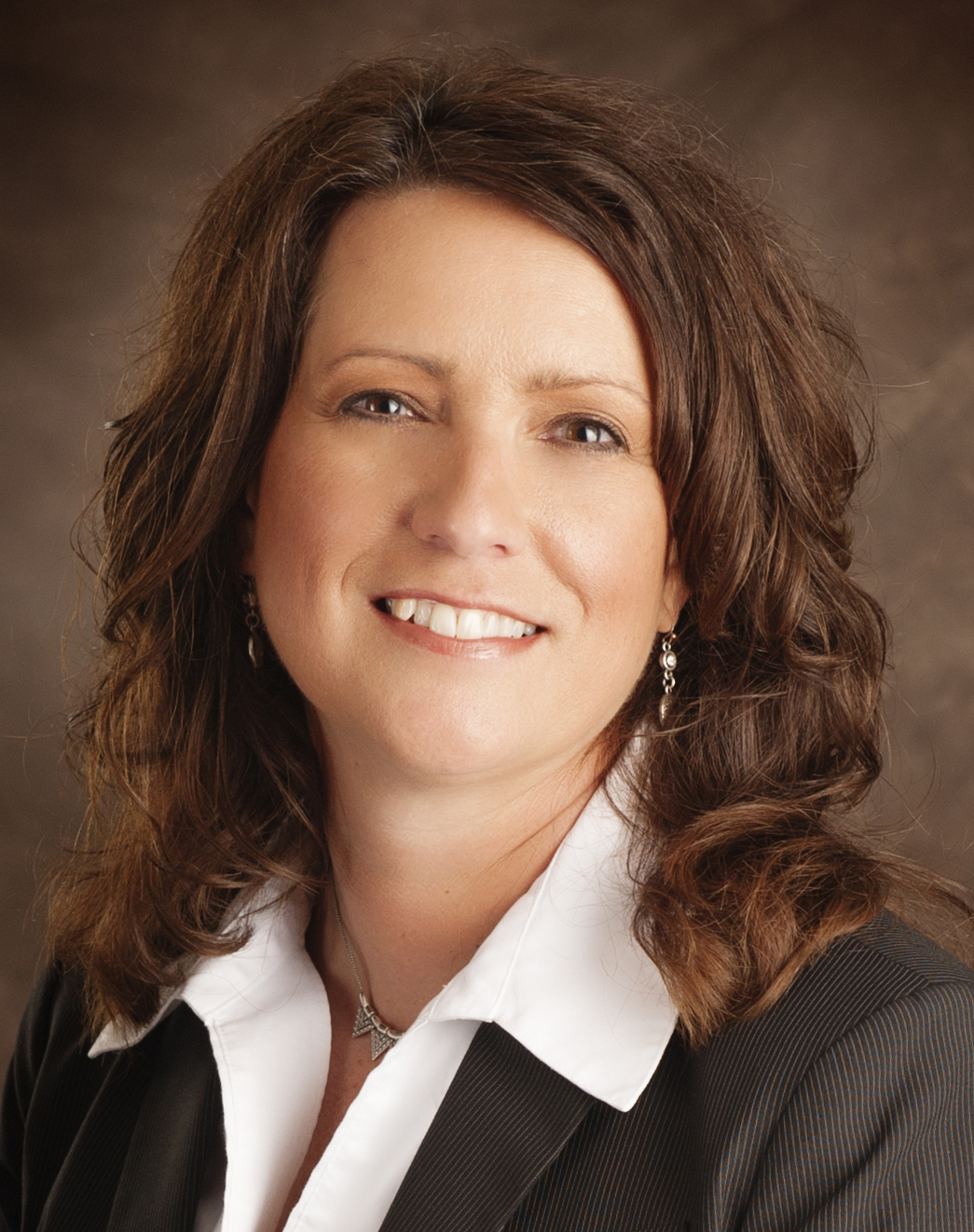 Angela P. Littrell, CPA, MBA, Chief Financial Officer & Chief Operating Officer